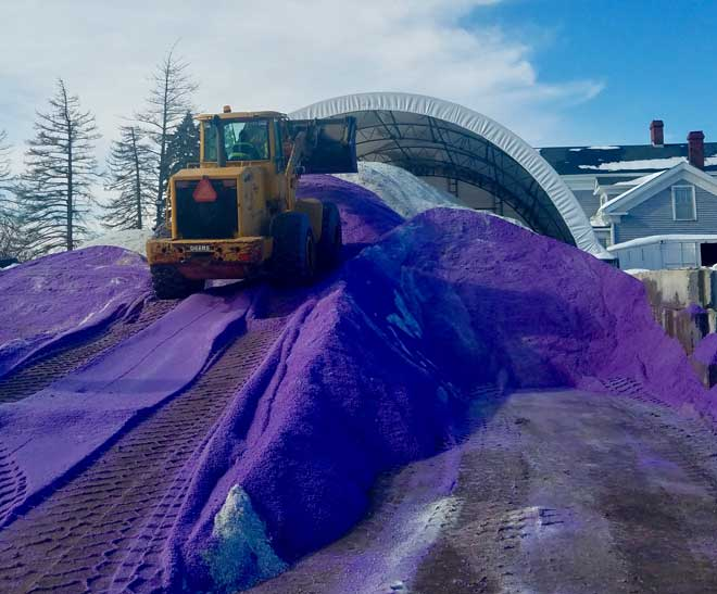 a snow plus front end loader stock piling salt for snow and ice control during a chicago il winter